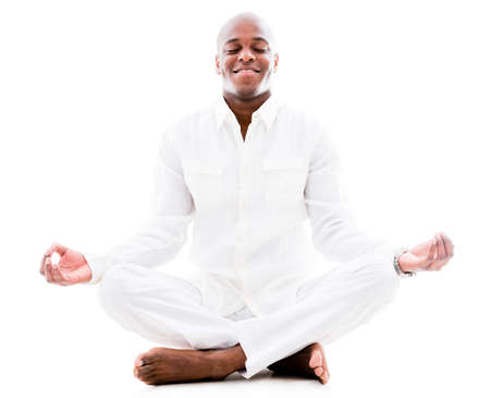 Peaceful man doing yoga and meditating - isolated over a white background Stock Photo - 20924538
