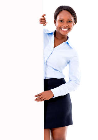 Happy business woman holding a banner - isolated over white photo