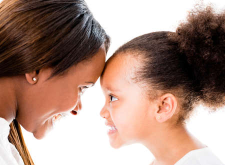 Loving mother and daughter with heads together - isolated over white Stock Photo - 20962039
