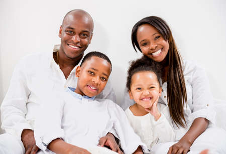 Portrait of a beautiful family looking very happy photo