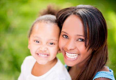 Beautiful portrait of a mother and daughter smiling outdoors Stock Photo - 20962056
