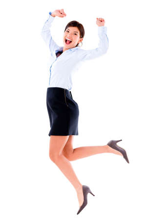Excited business woman jumping with arms up - isolated over white photo