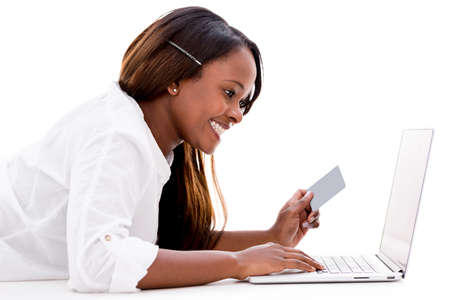 Woman paying online with a credit card - isolated over white photo