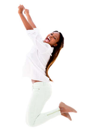 Happy woman jumping with arms up - isolated over a white background photo
