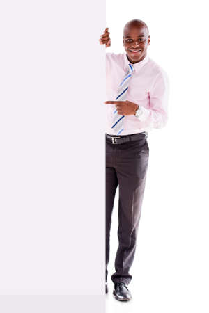 african businessman: Business man pointing at a banner - isolated over white