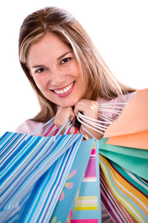 Happy female shopper holding shopping bags - isolated over white Stock Photo - 21203444