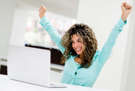 winning business woman: Successful business woman working online at the office