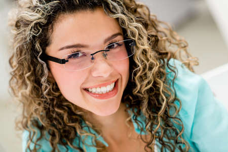 Portrait of a happy woman wearing glasses indoors photo