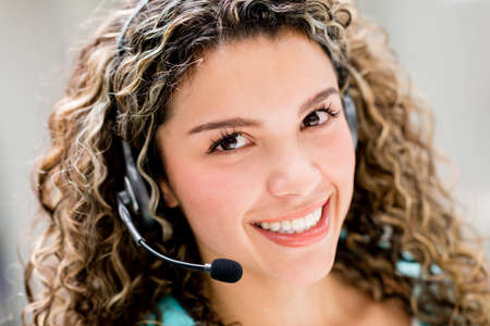 Customer service operator looking very friendly and smiling Stock Photo - 21467316