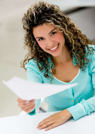 woman handle success: Business woman handling documents at the office
