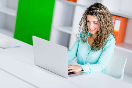 Successful business woman working online at the office Stock Photo - 21467335