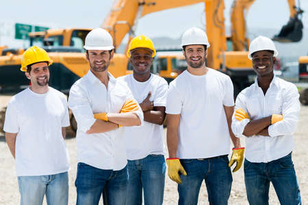 building worker: Group of working men at a construction site Stock Photo