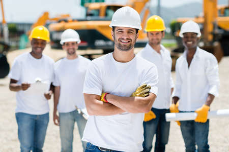 Happy group of construction workers at a building site Stock Photo - 21467340