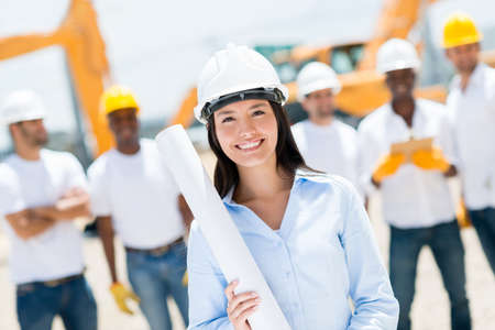 Female engineer at a construction site looking happy photo