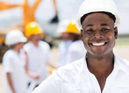 Happy male engineer at a construction site smiling photo