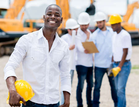 Male engineer at the construction site looking very happy photo