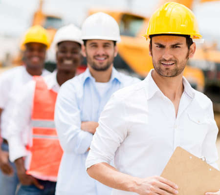 Group of architects and engineers working at a construction site Stock Photo - 21467358