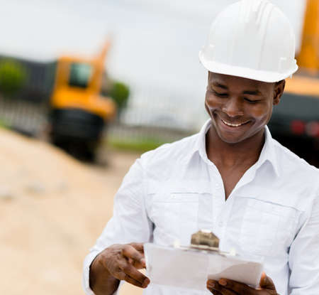 engineering clipboard: Civil engineer working at a building site