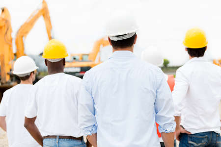 Group of architects looking at a construction site Stock Photo - 21467370