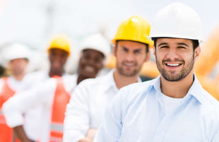 engineer: Group of architects and engineers at a building site