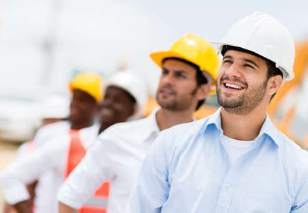 construction workers: Group of working men at a construction site Stock Photo