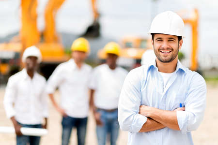 real leader: Male architect at a construction site looking happy Stock Photo