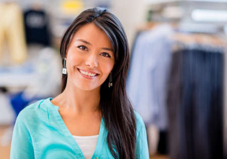 Happy shopping woman at a clothing store Stock Photo - 21467388