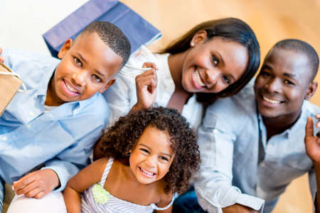 happy black family: Beautiful family portrait shopping at the mall