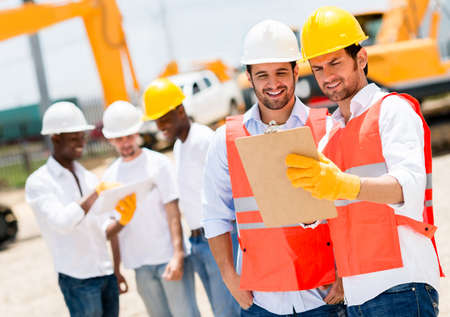 engineering clipboard: Team of architects working at a construction site
