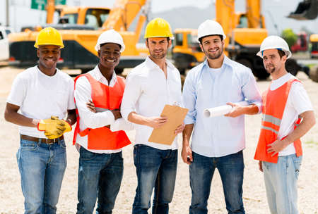 Group of architects at a building site looking happy Stock Photo - 21467422