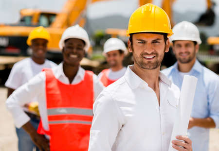 Architect with a group of construction workers holding blueprints Stock Photo - 21467424