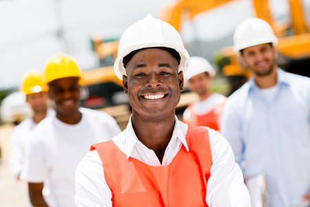 Civil engineer at a building site wearing a helmet Stock Photo
