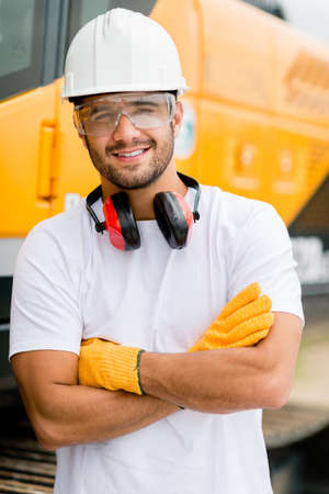 construction: Worker at a construction site working with heavy machines Stock Photo
