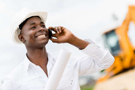 Architect making business call at a construction site photo