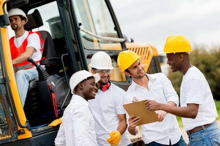 Group of engineers working at a construction site Stock Photo - 21467432
