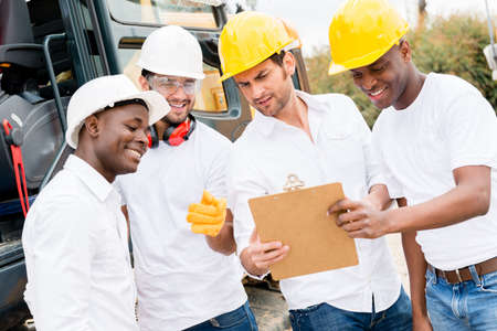 Group of men working on a construction site Stock Photo - 21467436