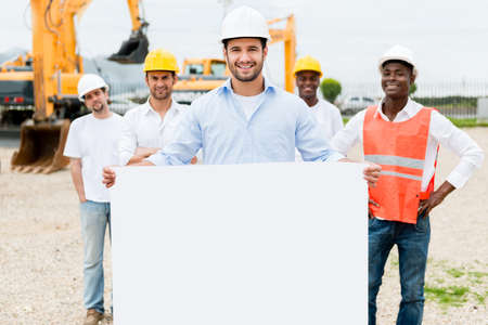 Architect holding a banner at a building site photo