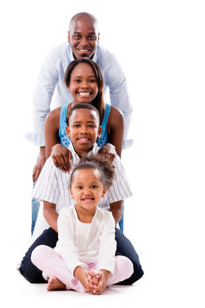 american children: Beautiful family smiling and looking very happy - isolated over white