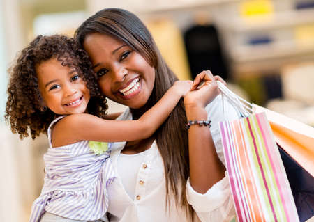 shoppers: Portrait of a mother and daughter shopping and looking happy