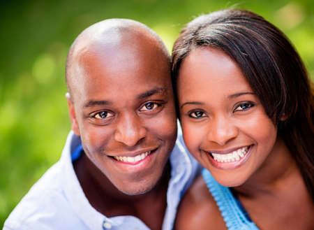 american content: Portrait of a beautiful couple smiing outdoors Stock Photo