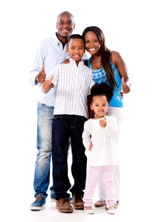 Happy family with thumbs up - isolated over a white background photo
