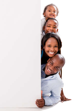 black woman white man: Beautiful happy family with a banner - isolated over white Stock Photo