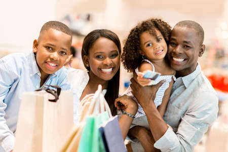 Portrait of a happy family shopping and smiling Stock Photo