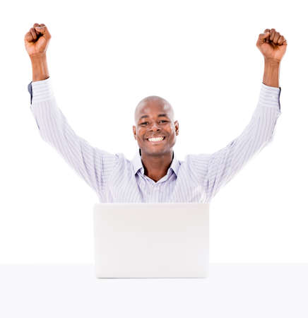 Business man happy with his online success - isolated over white photo