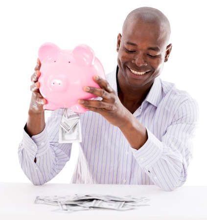 Business man taking money from his savings - isolated over white Stock Photo - 21559352