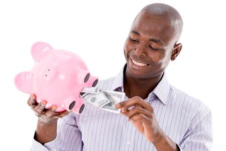coinbank: Hombre que toma el dinero de una hucha - aislado sobre fondo blanco