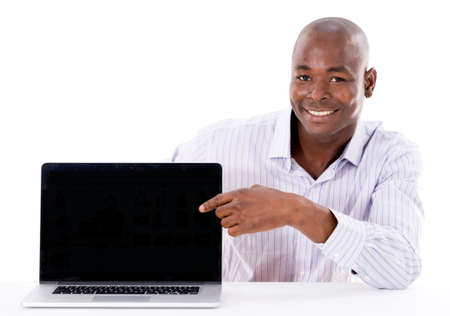 Business man pointing something on a laptop screen - isolated over white