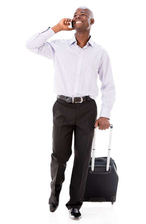 Man going on a business trip and talking on the phone - isolated over white photo