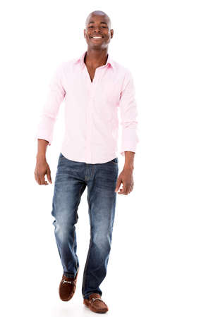 Casual African American man walking - isolated over a white background Stock Photo