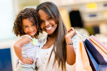 shopping malls: Happy mother and daughter shopping at a retail store Stock Photo